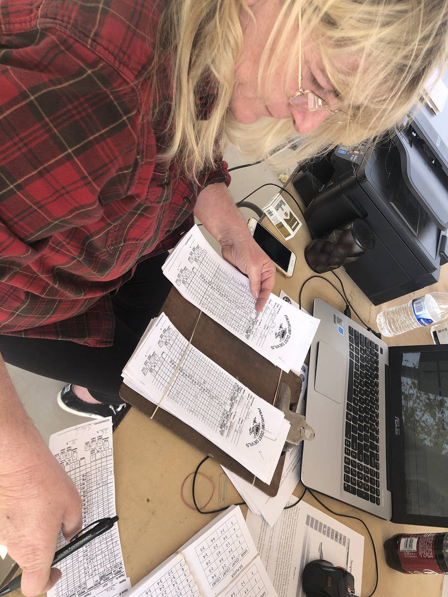 Tom Rysinski/Pahrump Valley Times Inundated with score sheets, Stacie Nicosia works to enter th ...