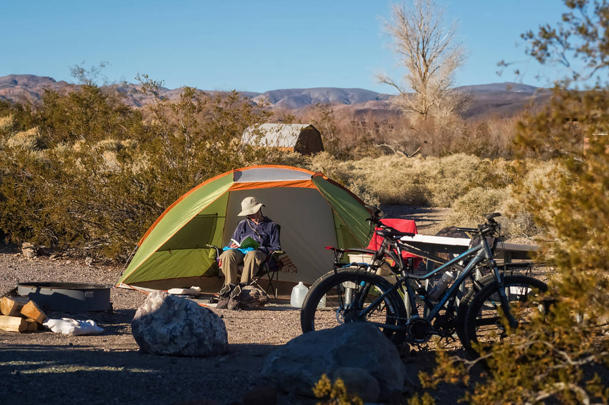 Kurt Moses/NPS A camper marvels at the splendor of Mesquite Spring Campground in Death Valley N ...