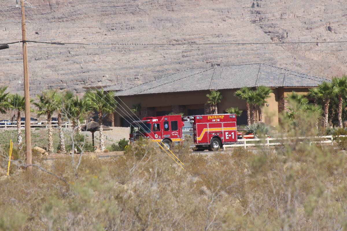 Jeffrey Meehan/Pahrump Valley Times A fire truck responds after a helicopter landed in a lake ...