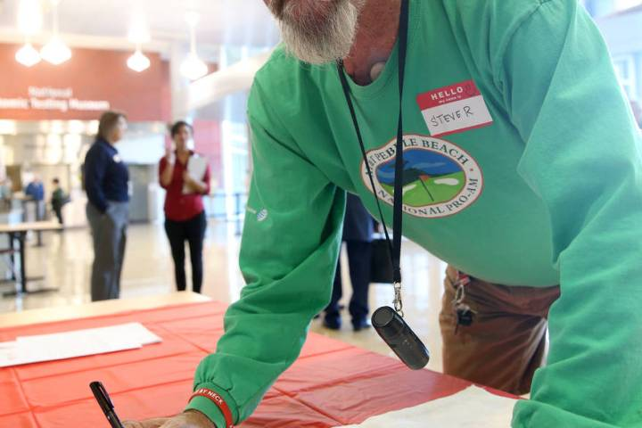 K.M. Cannon/Las Vegas Review-Journal Steve Radley, 73, of Pahrump, signs a banner during the Co ...