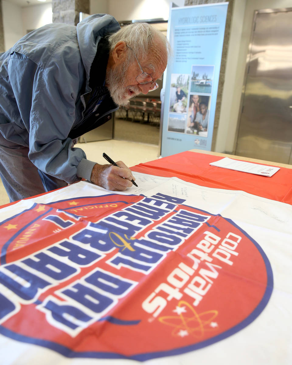 K.M. Cannon/Las Vegas Review-Journal Donald Miller, 79, of Las Vegas, signs a banner during the ...