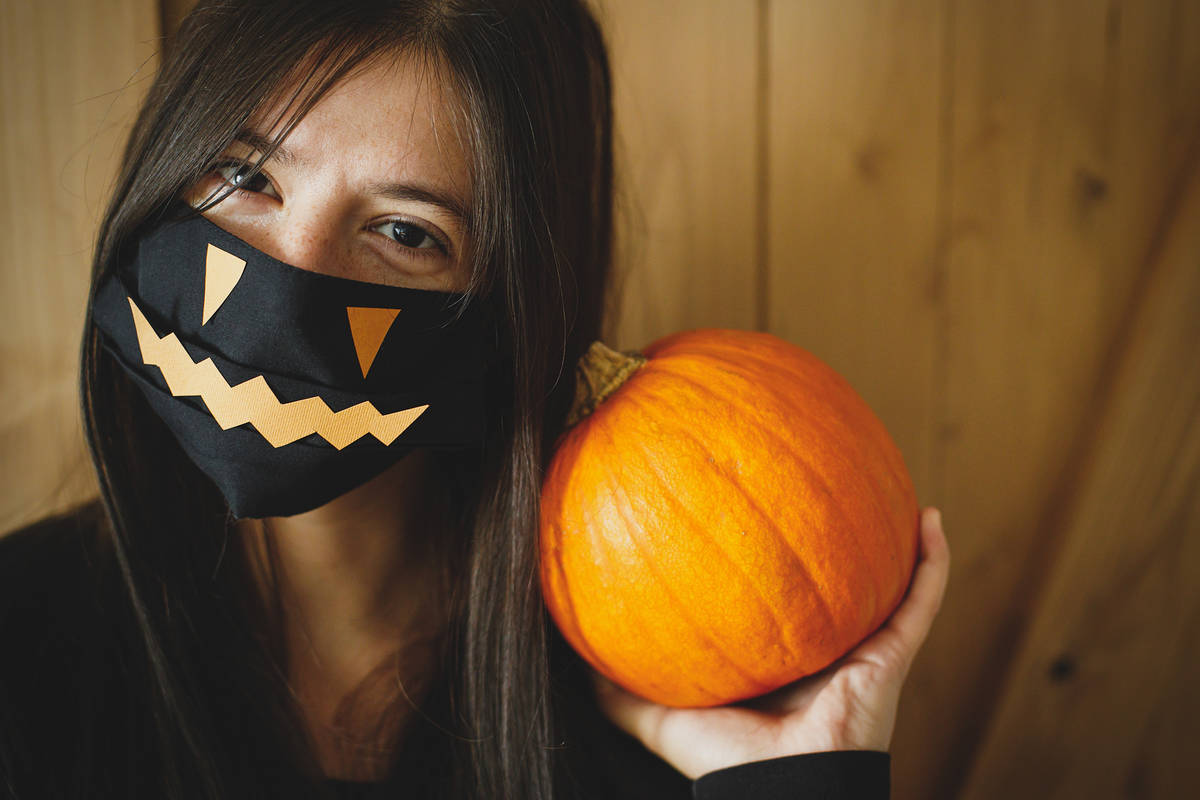 Getty Images A Halloween mask is not a substitute for a cloth face mask, and a costume mask sh ...