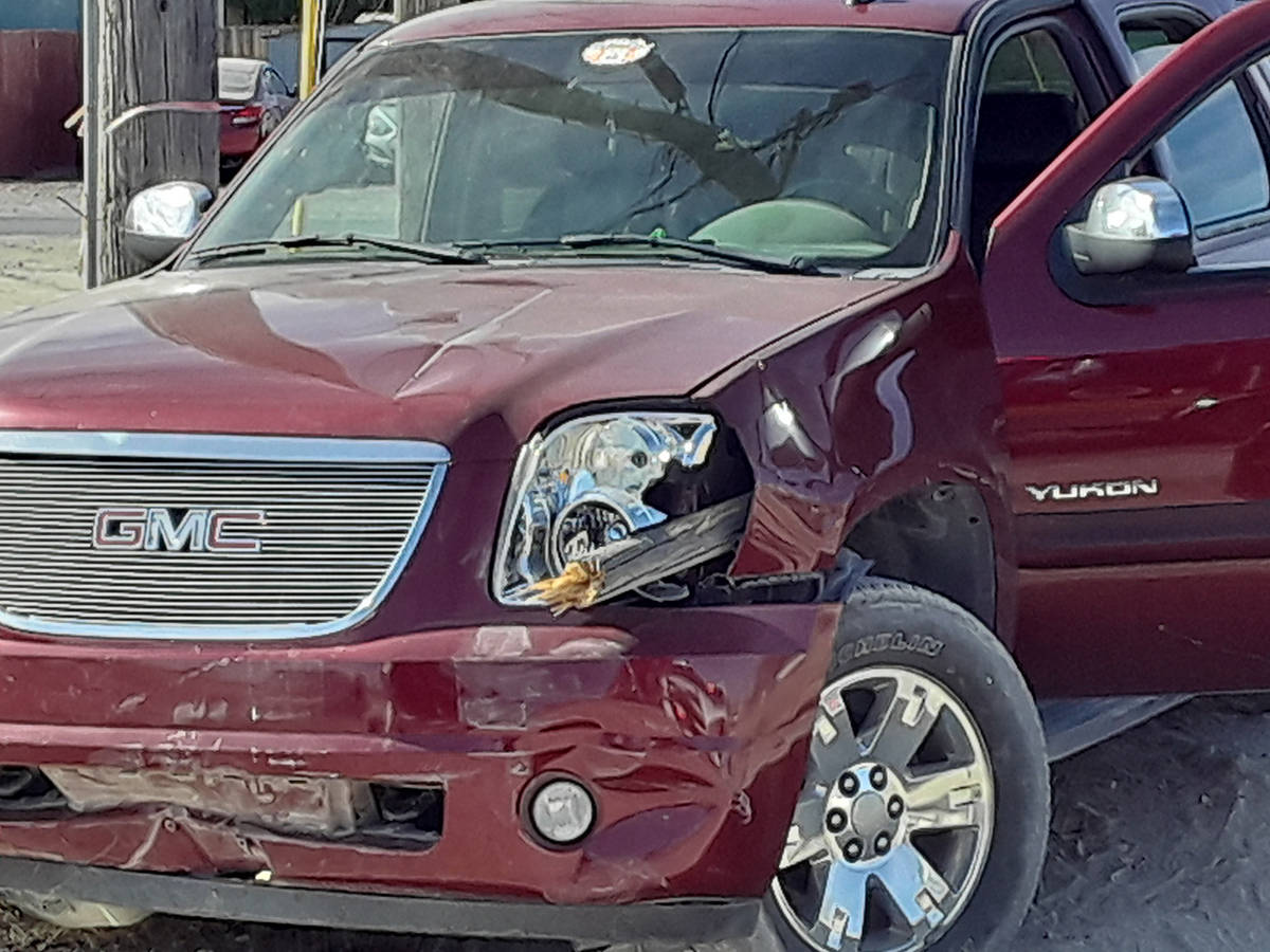 Selwyn Harris/Pahrump Valley Times A piece of a utility pole impaled the driver's side headligh ...