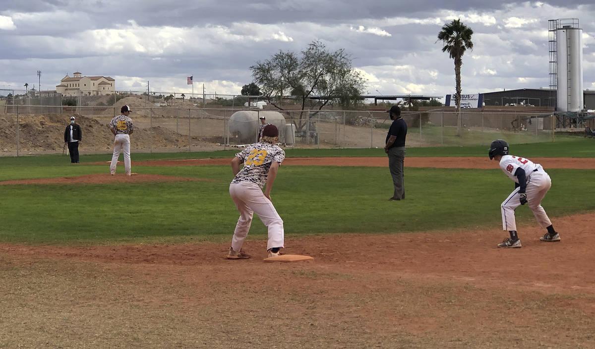 Tom Rysinski/Pahrump Valley Times First baseman Scott Oscarson holds a Redlands Bulldogs Red ru ...