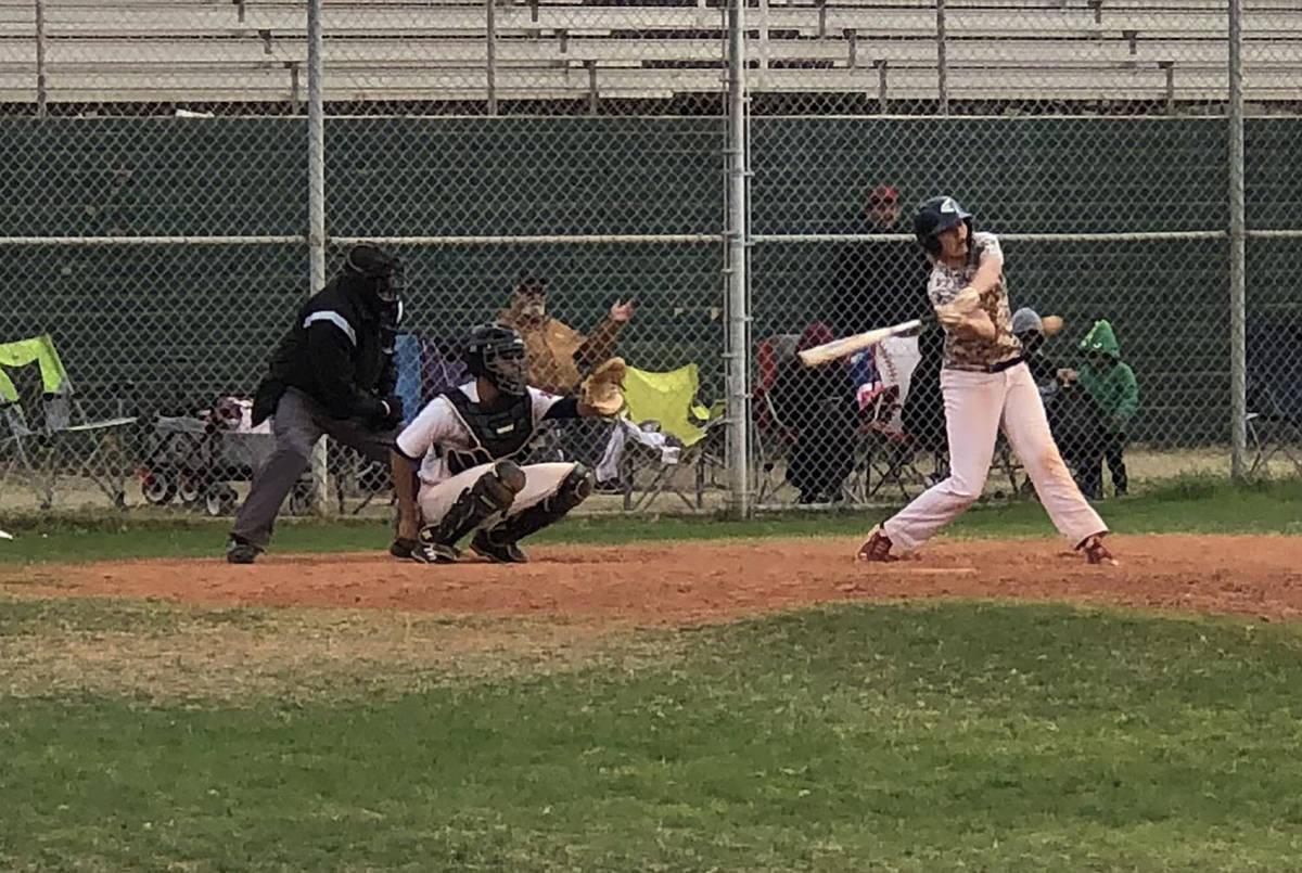 Tom Rysinski/Pahrump Valley Times Scott Oscarson keeps his eye on the ball as he bats for Pahru ...