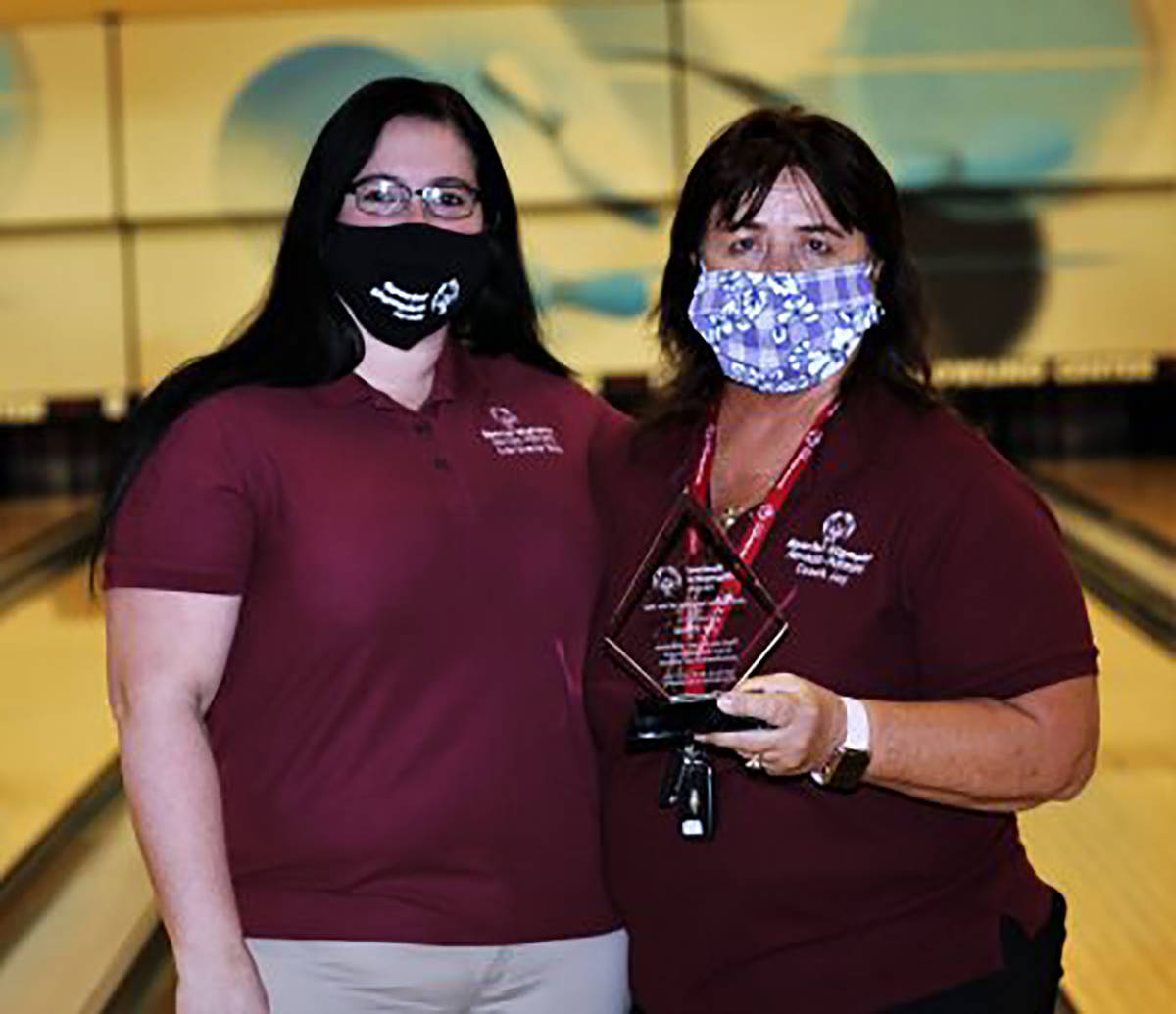 Randy Gulley/Special to the Pahrump Valley Times Joy Theus, right, accepts an award from Bobbi- ...