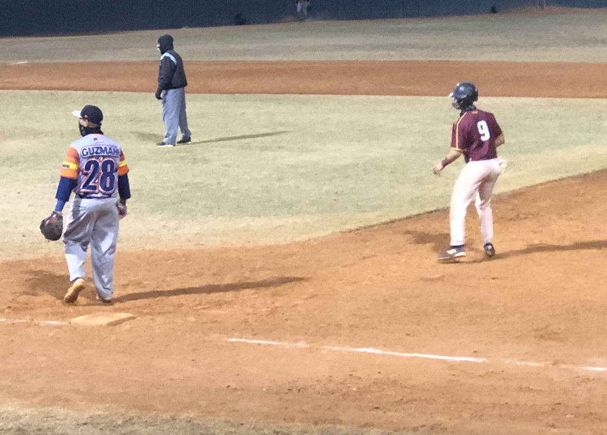 Tom Rysinski/Pahrump Valley Times Pahrump Trojans Gold's Coby Tillery takes a lead off first ba ...