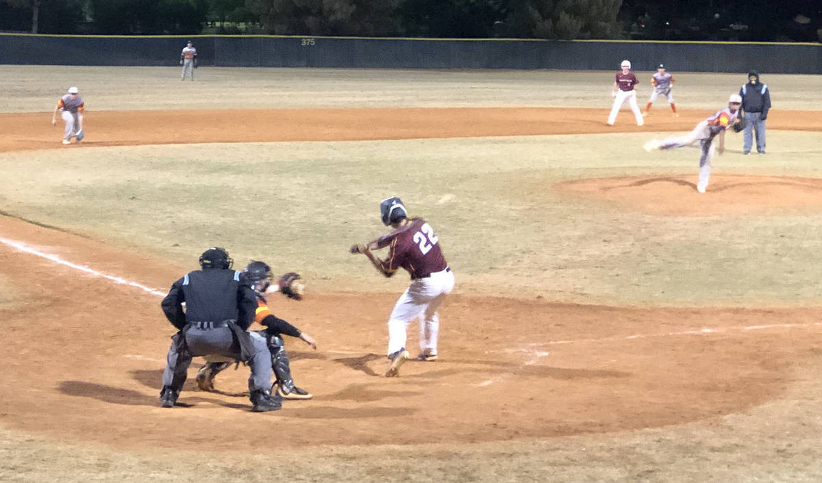 Tom Rysinski/Pahrump Valley Times Zack Cuellar eyes an incoming pitch during Friday night's Pah ...