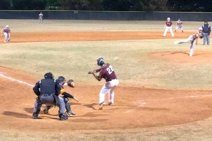 Tom Rysinski/Pahrump Valley Times Zack Cuellar eyes an incoming pitch during Friday night's Pah ...