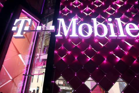 K.M. Cannon Las Vegas Review-Journal The T-Mobile store on the Strip on opening night Thursday, ...