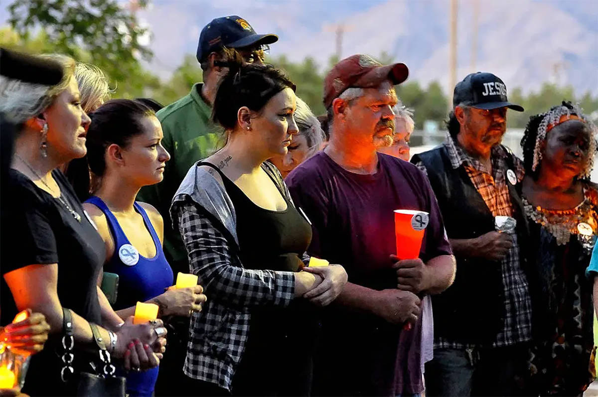 Horace Langford Jr./Pahrump Valley Times Members of the community held a candlelight vigil in t ...