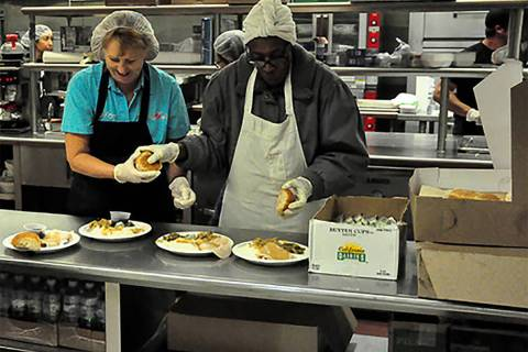 Selwyn Harris/Pahrump Valley Times This file photo shows volunteers preparing food for the Comm ...
