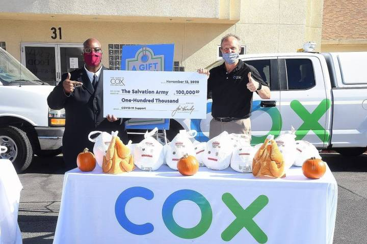 Special to the Pahrump Valley Times Captain Anthony Barnes with Cox's David Diers, with $100 ...