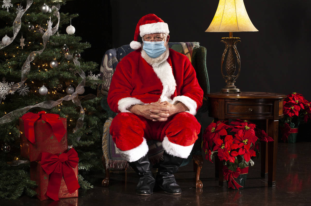 horizontal photograph of Santa Claus Sitting in a Chair Wearing a Surgical Mask and Looking Tow ...