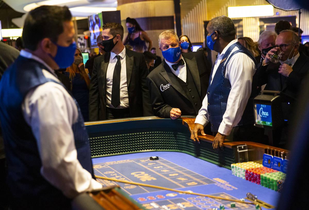 Chase Stevens/Las Vegas Review-Journal Circa owner Derek Stevens checks on a craps table shortl ...
