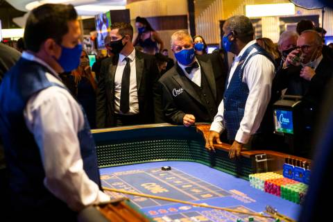 Chase Stevens/Las Vegas Review-Journal Circa owner Derek Stevens checks on a craps table shortl ...