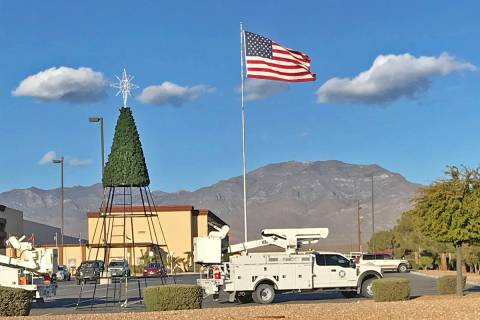 Robin Hebrock/Pahrump Valley Times Crews with Valley Electric Association are seen erecting the ...