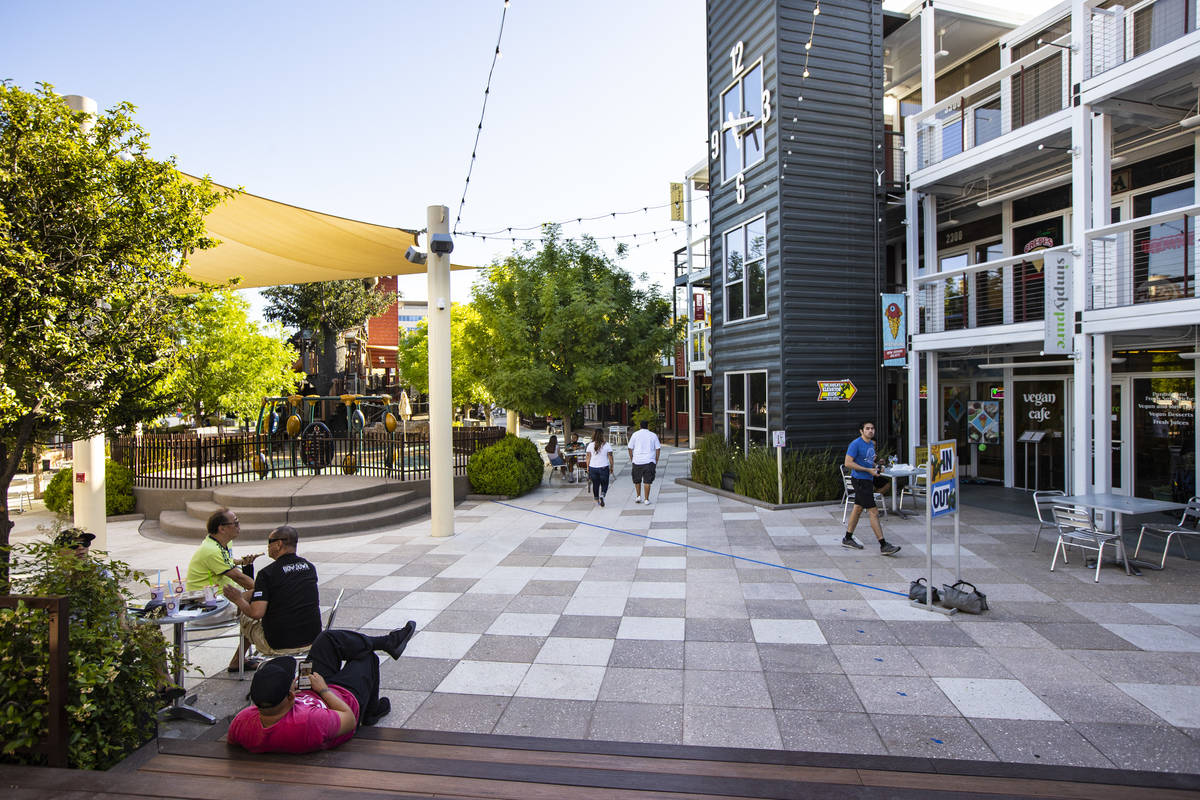 People walk around the Downtown Container Park on the first day of its reopening in downtown La ...