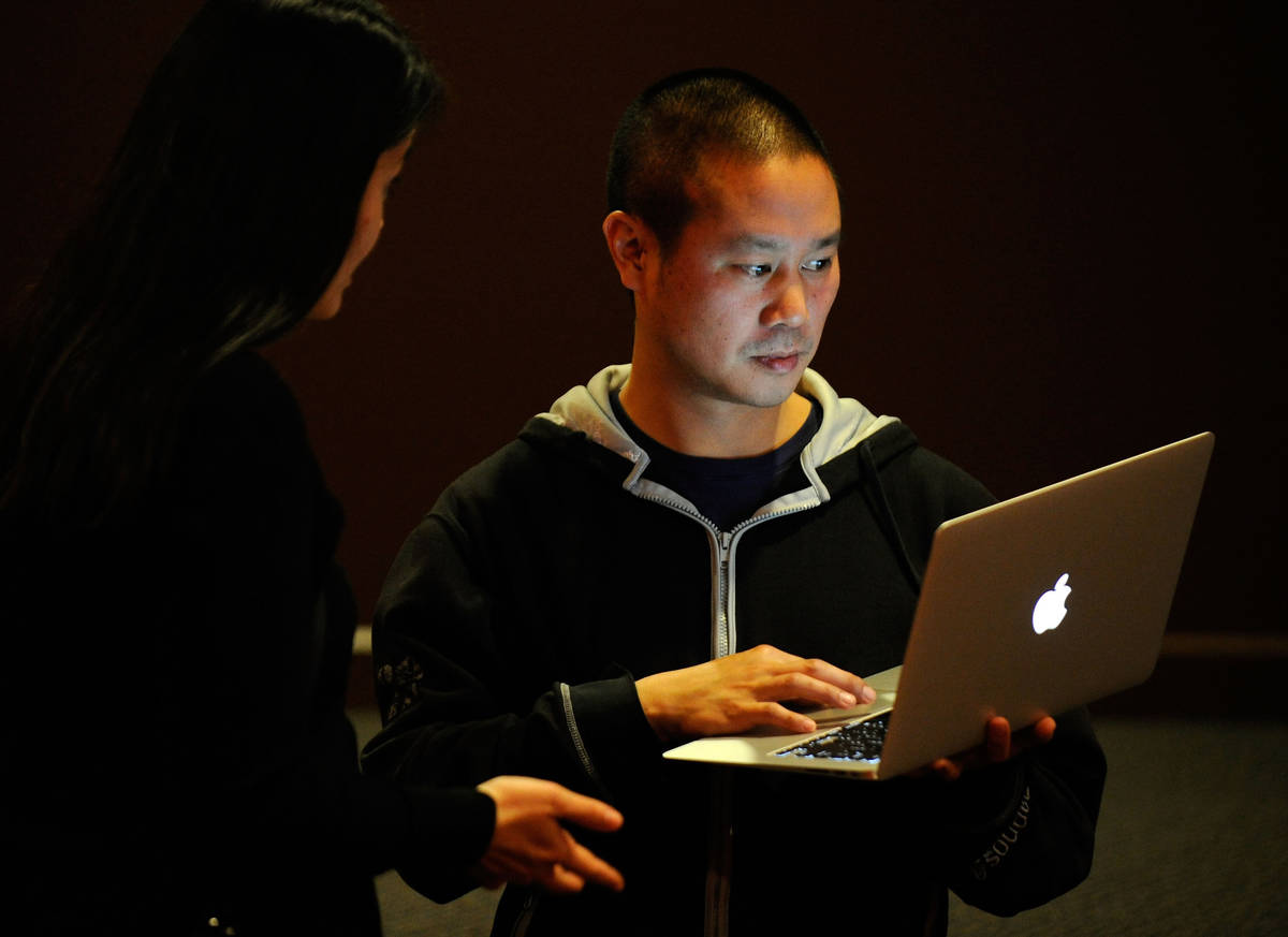 In this Jan. 28, 2012, file photo, Zappos CEO Tony Hsieh works on his laptop computer before th ...