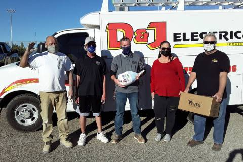 Selwyn Harris/Pahrump Valley Times Holding a Thanksgiving dinner package, D&J Electrical Servic ...