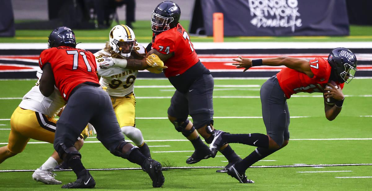 UNLV Rebels quarterback Doug Brumfield (17) runs the ball against the Wyoming Cowboys during th ...