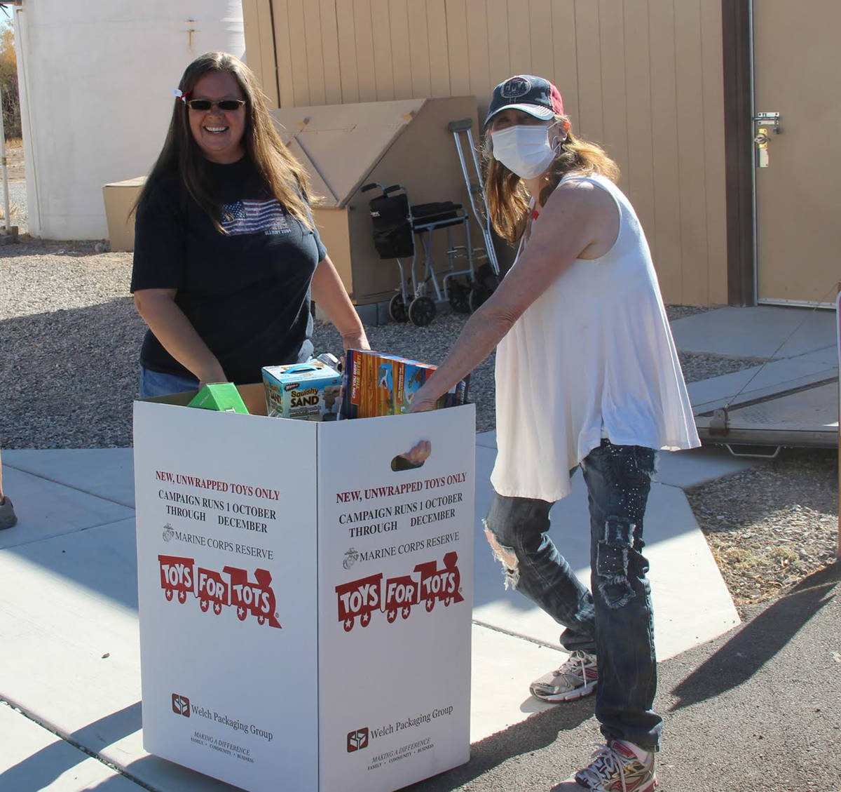 Special to the Pahrump Valley Times Volunteers manning the VFW's Toys for Tots Poker Run are se ...