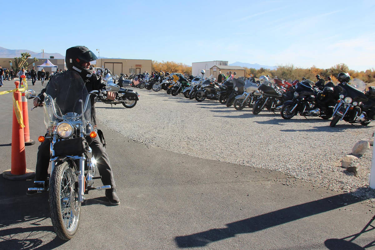 Special to the Pahrump Valley Times A VFW Toys for Tots Poker Run participant is seen readying ...