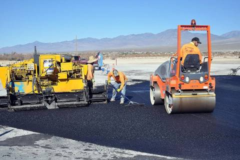 Horace Langford Jr./Pahrump Valley Times Work crews are seen paving a portion of the parking l ...