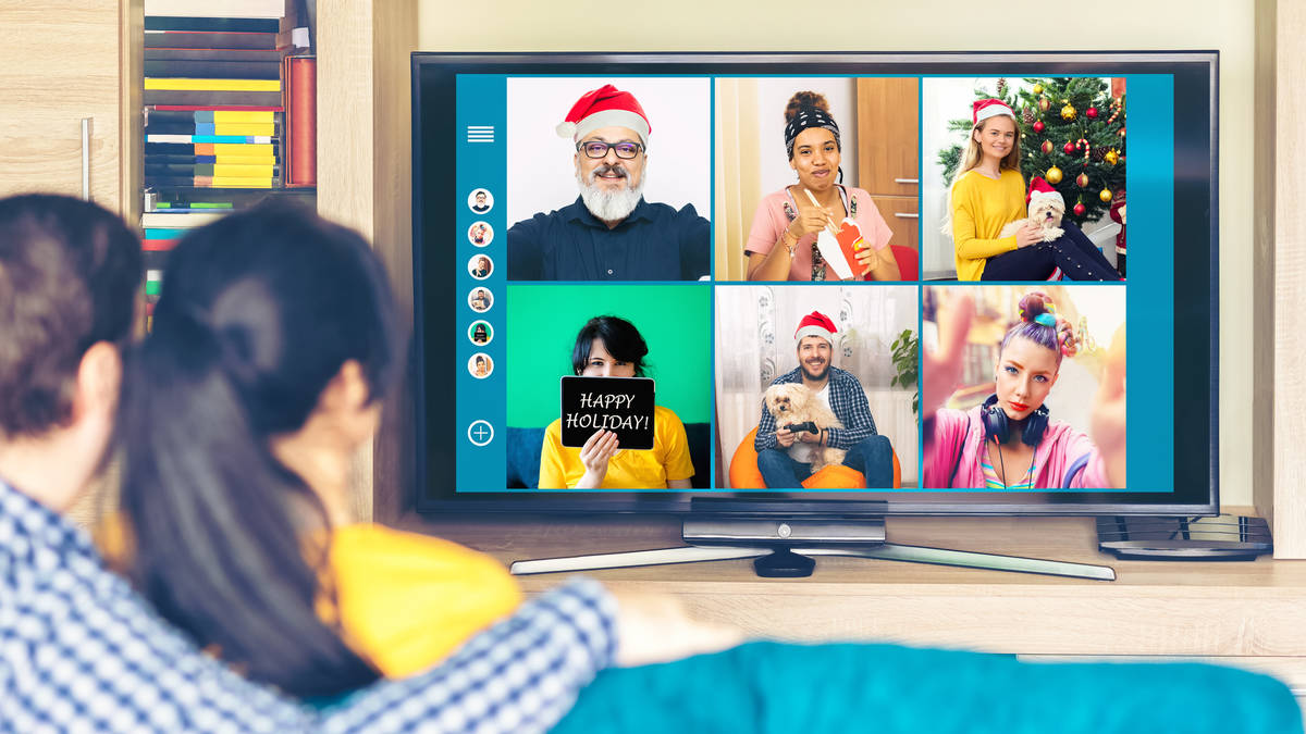 Getty Images Multicultural friends celebrating Christmas online at home quarantine.