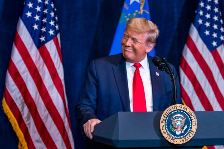 L.E. Baskow/Las Vegas Review-Journal President Donald Trump listens to statements by Nevada bus ...