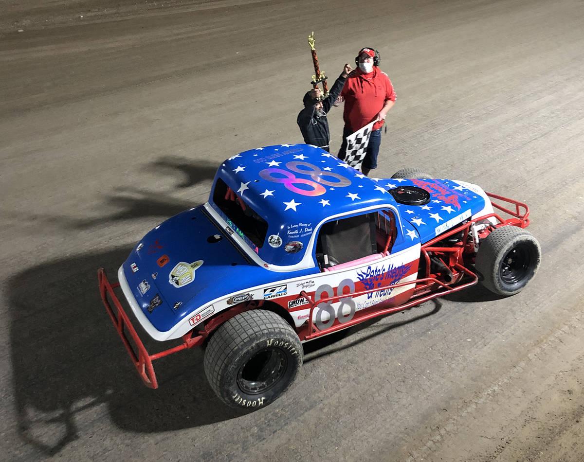 Tom Rysinski/Pahrump Valley Times Mark Daub celebrates his win in the Coupe race with flagman D ...