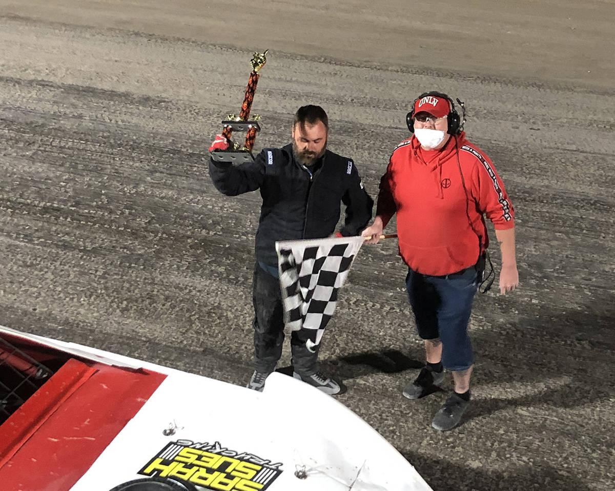 Tom Rysinski/Pahrump Valley Times Tyson Talkington raises his trophy after winning in Super Sto ...