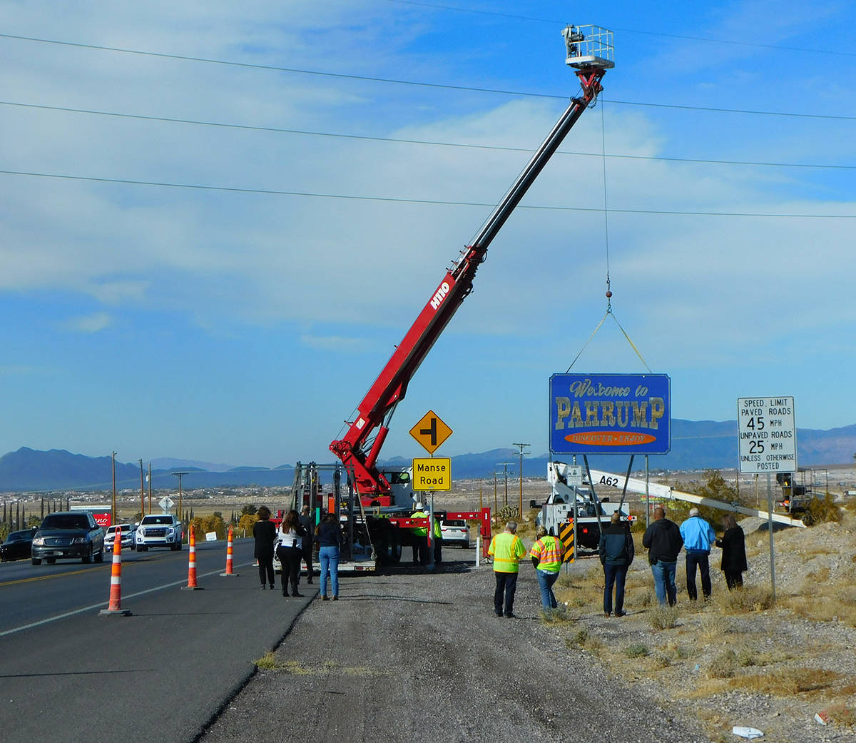 Robin Hebrock/Pahrump Valley Times Work crews with High Impact Signs and Designs are seen remov ...