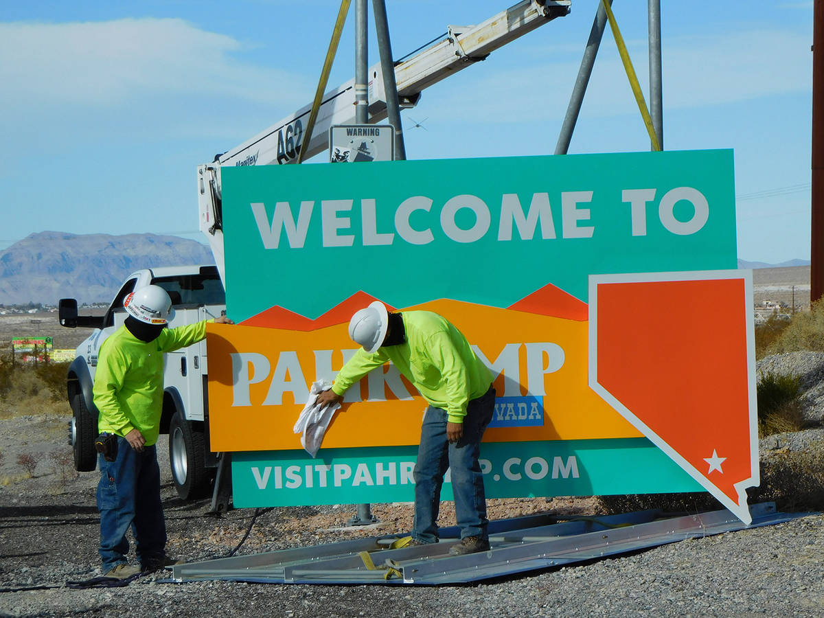 Robin Hebrock/Pahrump Valley Times Work crews give the new welcome signs a wipe-down prior to i ...