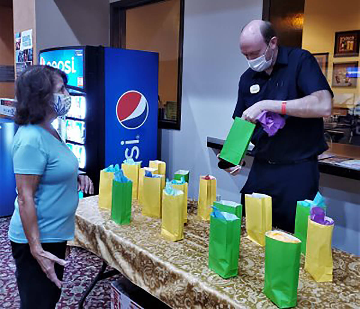 Special to the Pahrump Valley Times Juanita Martinez, left, picks out a grab-bag prize during t ...