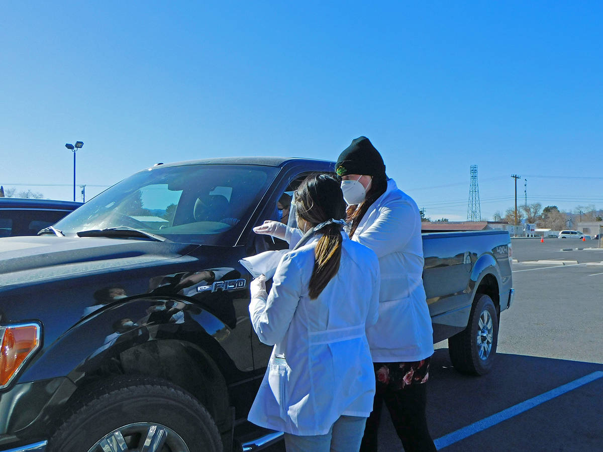 Robin Hebrock/Pahrump Valley Times Officials with Immunize Nevada are shown organizing paperwor ...