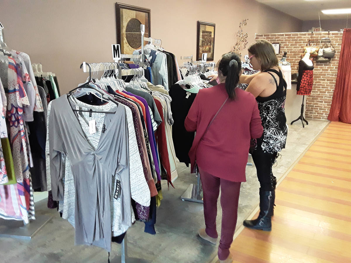 Selwyn Harris/Pahrump Valley Times A sales associate assists a shopper at Social Distraction Fa ...