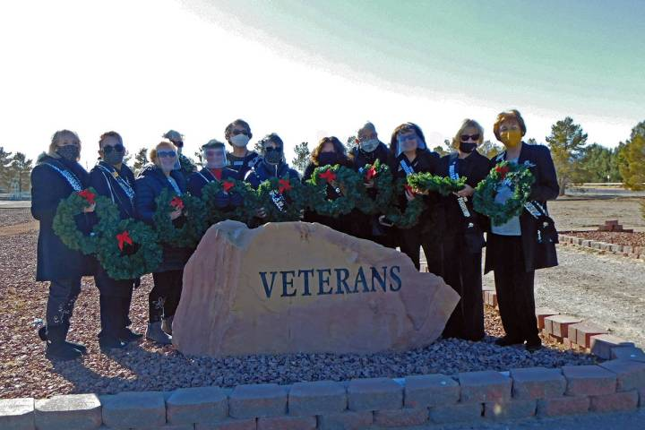 Robin Hebrock/Pahrump Valley Times The Nevada Silver Tappers are pictured holding the new Chris ...