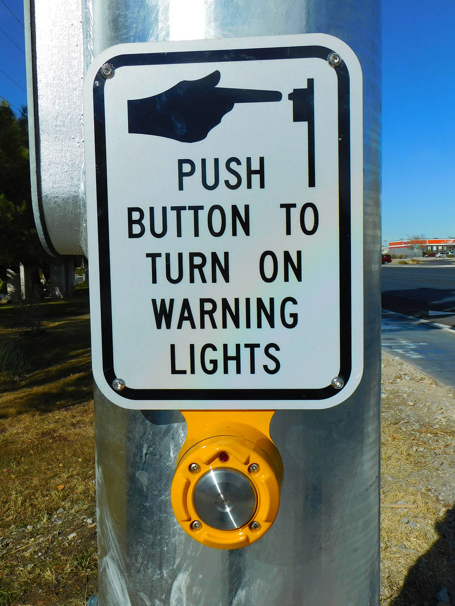 Robin Hebrock/Pahrump Valley Times The new crosswalk includes a push-button activated overhead ...