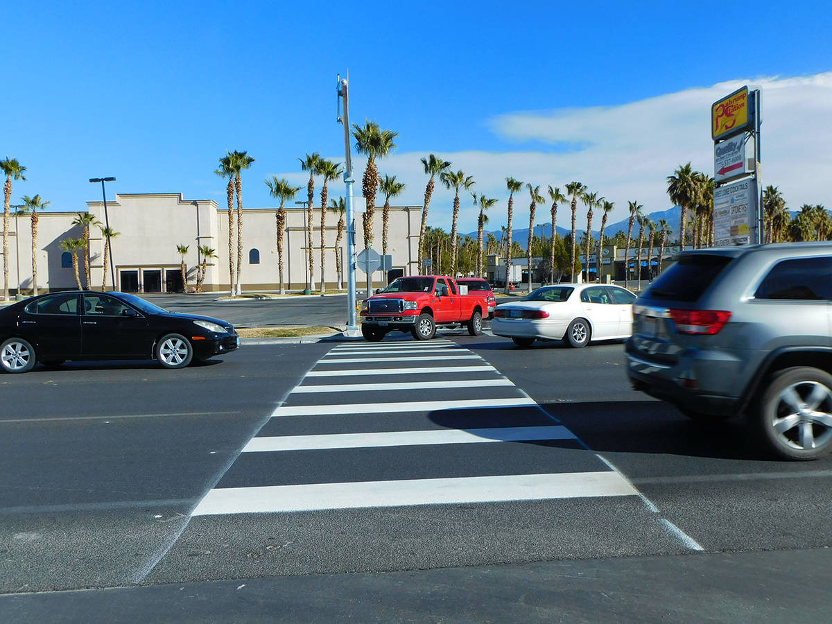 Robin Hebrock/Pahrump Valley Times Bright white stripes have been painted across Highway 160, m ...