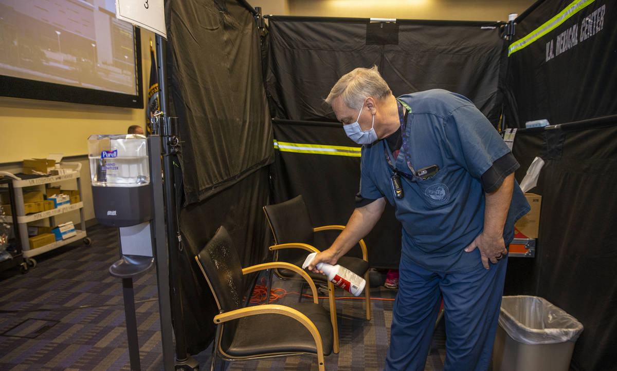 L.E. Baskow/Las Vegas Review-Journal RN Darrel Cowlishaw sanitizes his pod as some of the first ...