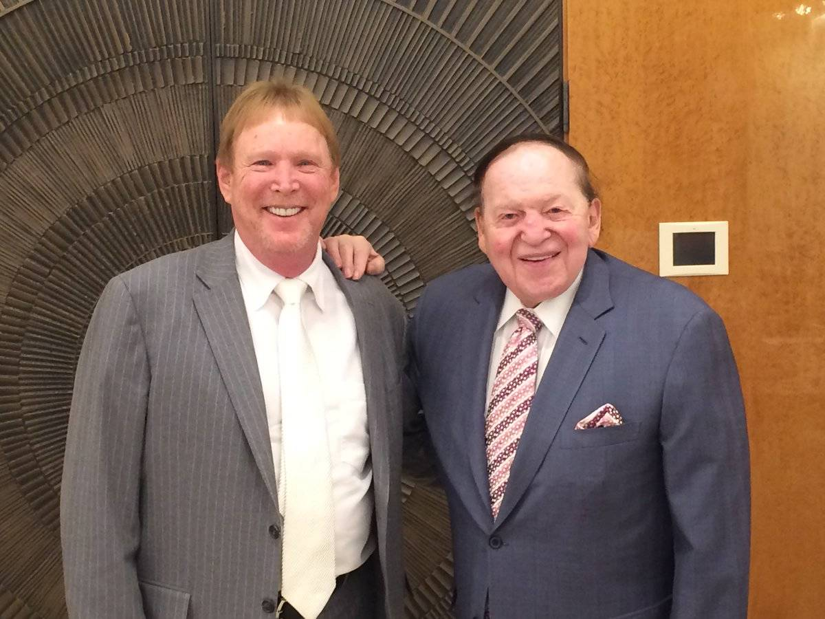 Raiders owner Mark Davis, left, and Sands Chairman and CEO Sheldon Adelson pose for a photo in ...
