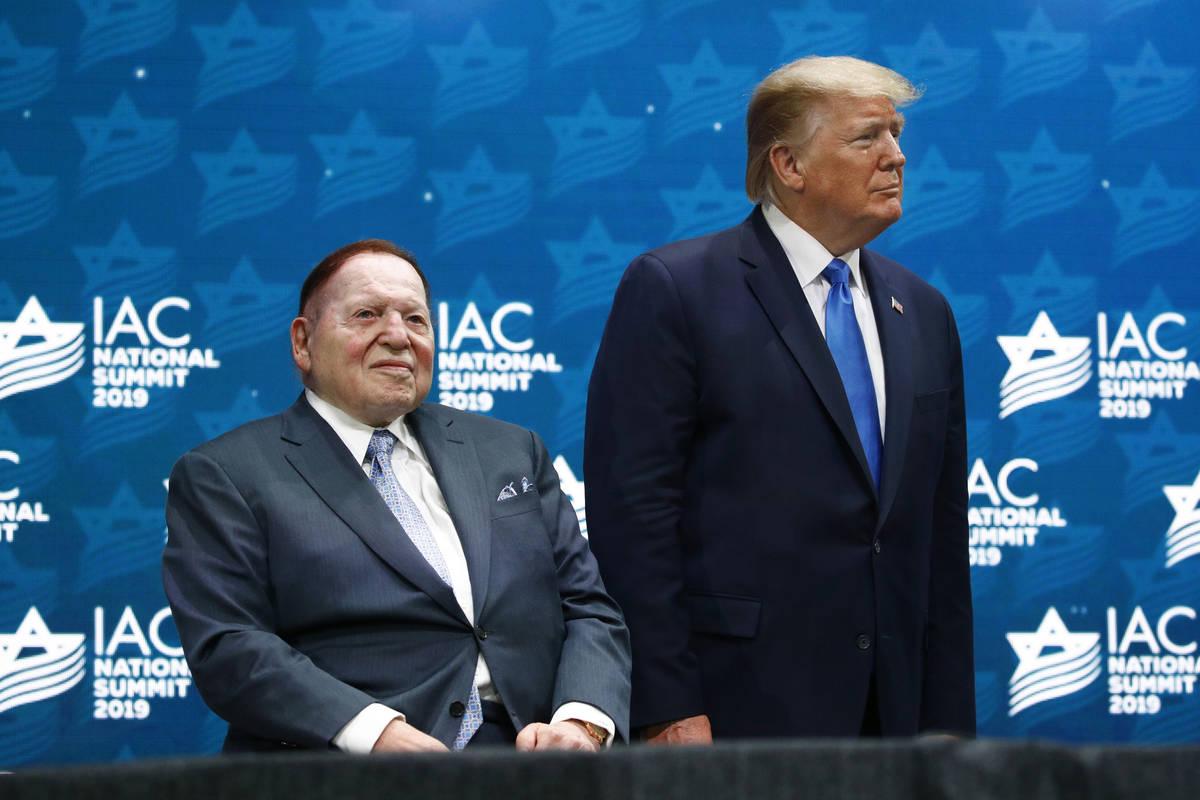 FILE - In this Dec. 7, 2019 file photo, President Donald Trump stands alongside Las Vegas Sands ...