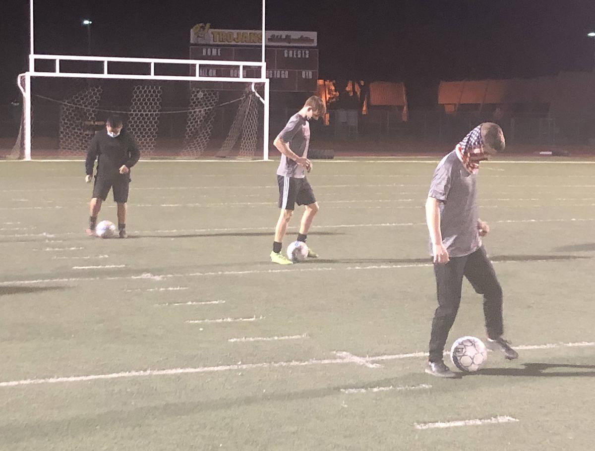 Tom Rysinski/Pahrump Valley Times Boys soccer players work through a drill during a conditionin ...