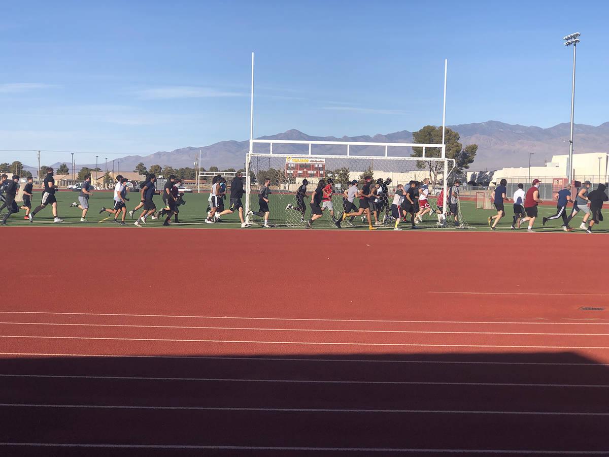 Tom Rysinski/Pahrump Valley Times Football players run a lap around the field before the start ...