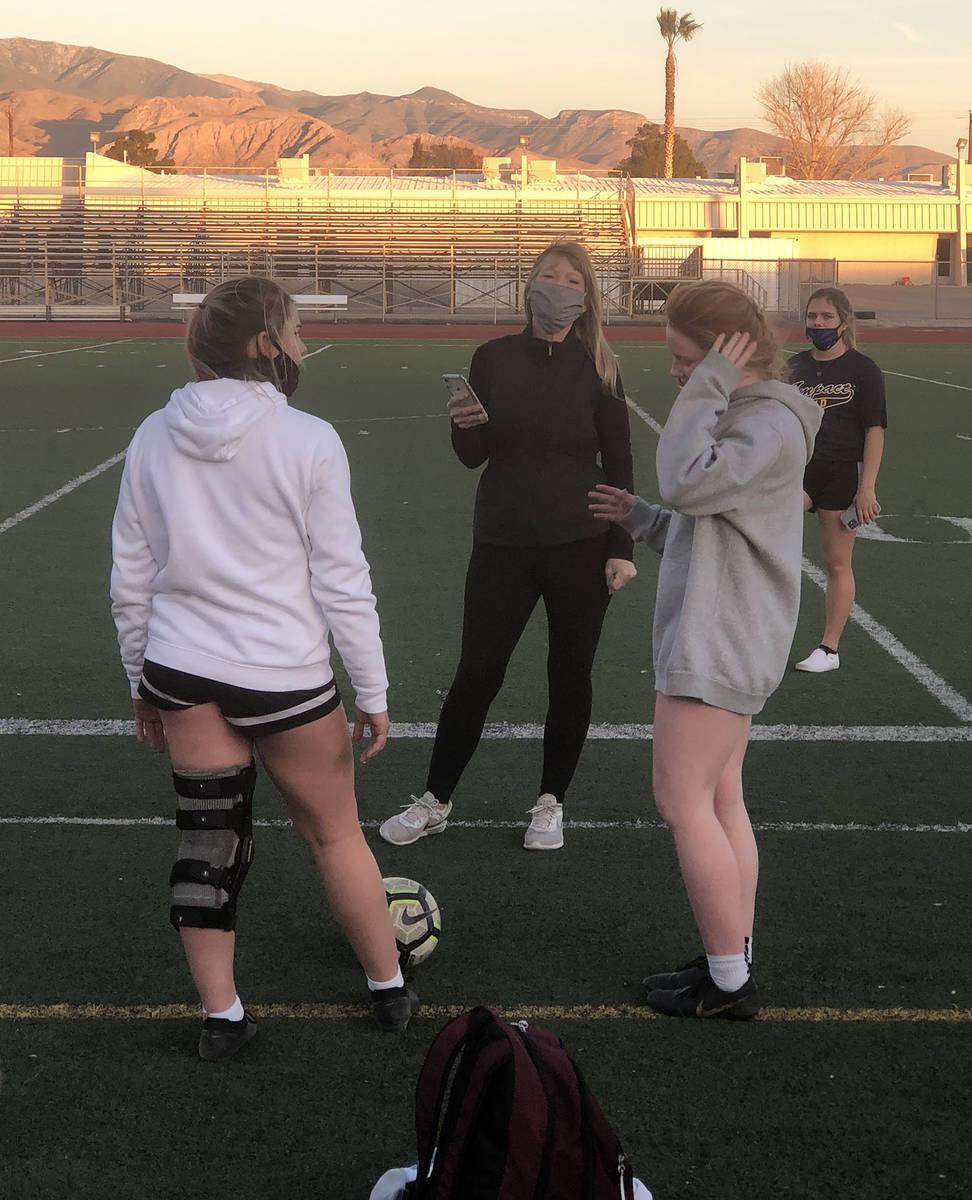 Tom Rysinski/Pahrump Valley Times Girls soccer coach Julie Carrington, center, talks to seniors ...