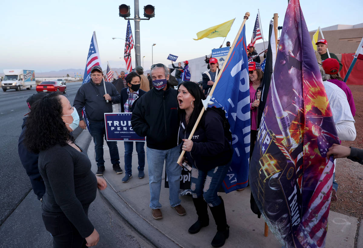 K.M. Cannon/Las Vegas Review-Journal Supporters of President Donald Trump argue with supporters ...