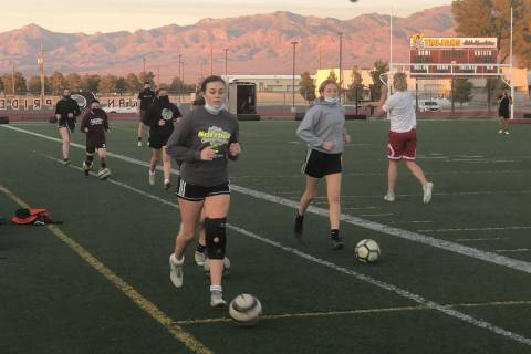 Tom Rysinski/Pahrump Valley Times Girls soccer players warm up before a conditioning session wh ...
