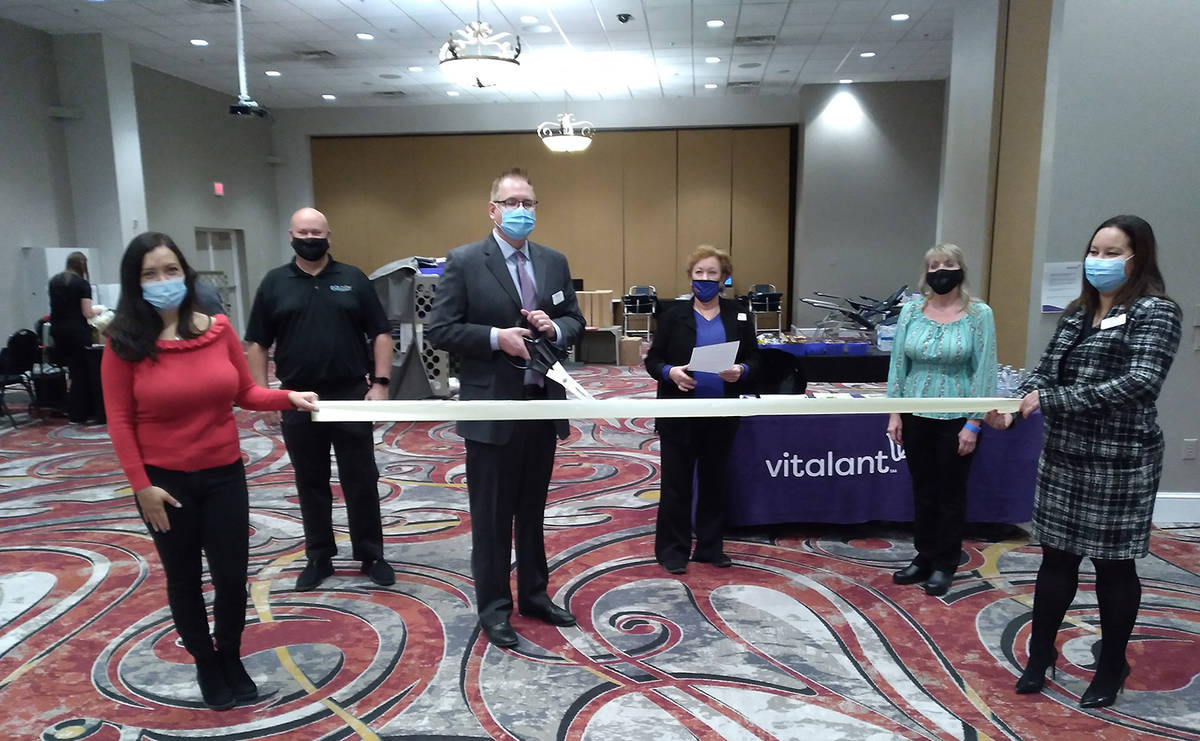 Selwyn Harris/Pahrump Valley Times Vitalant Regional Director Erik Hill prepares to cut the rib ...
