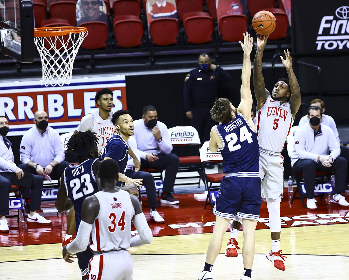 Chase Stevens/Special to the Pahrump Valley Times UNLV guard David Jenkins Jr. shoots over Utah ...